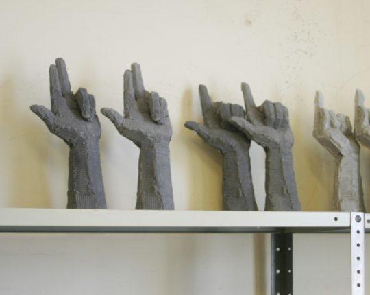 Six new hand sculptures being cast.